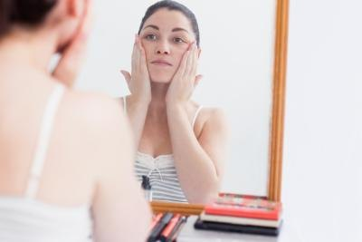 Use a mirror to locate the skin tag.