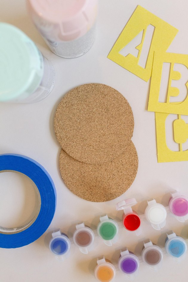Using only a handful of supplies you can easily personalize simple cork coasters.