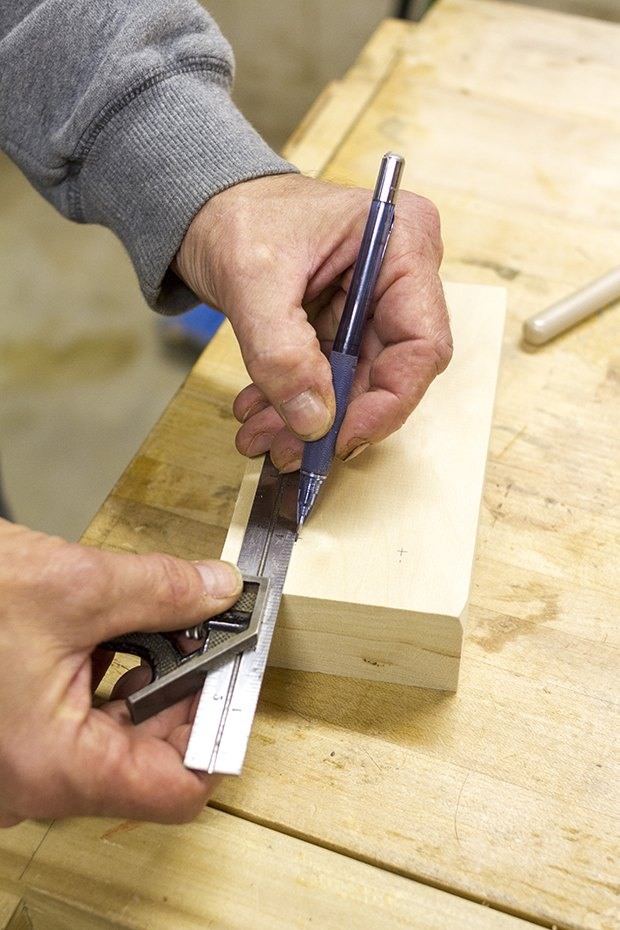 Use a ruler and pencil to make marks on the wood where the holes will go.