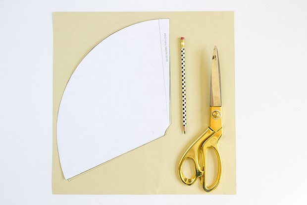 Retrace the paper hat template onto a piece of cream-colored cardstock paper.