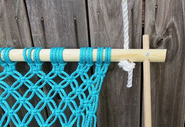 String the rope through the top of the frame and tie a loose knot.
