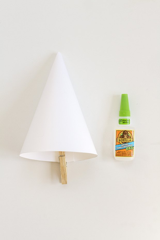 Use glue to finish the cone shape.