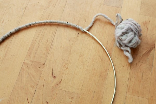 Wrap a store-bought brass ring with a neutral wool yarn.