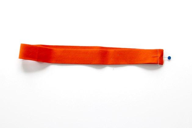 Sew elastic ends together.