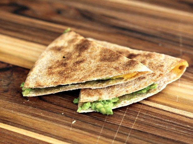 Start with wedges then cut your quesadillas into little squares, perfect for tiny fingers.