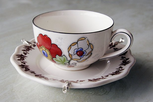 Glue the teacup to the saucer.