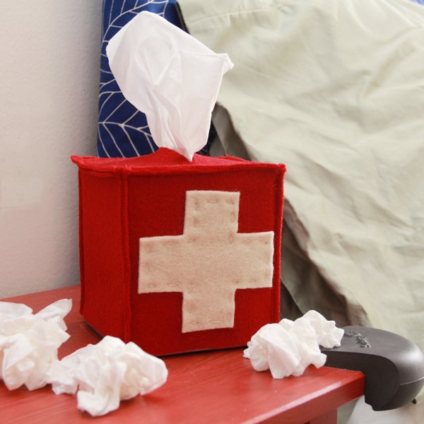 This felt-covered tissue box is made to look like a first aid kit.