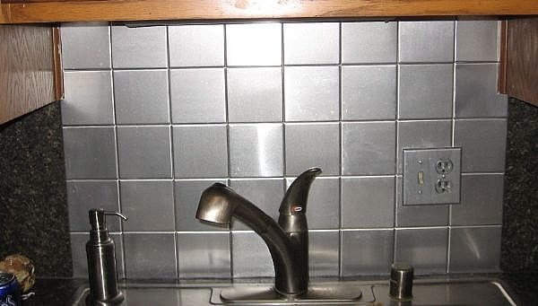 How to install a faux stainless steel backsplash for about - How to replace backsplash ...