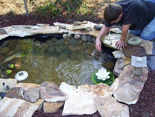 Construction of a diy pond ehow for Koi pond construction guide