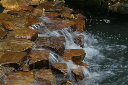 How to make a waterfall water feature for cheap ehow for Build your own waterfall pond