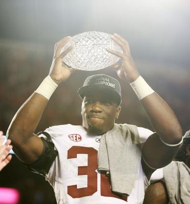University of Alabama football player celebrates after winning the 2013 BCS championship