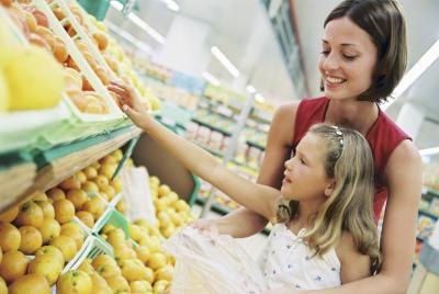 woman with daughter at grocery store