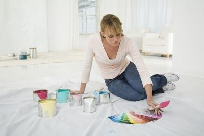 Woman looking at several paint swatches.
