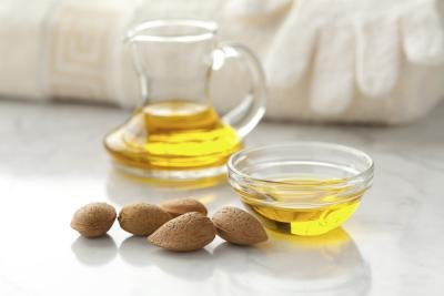 A small bowl of almond oil.