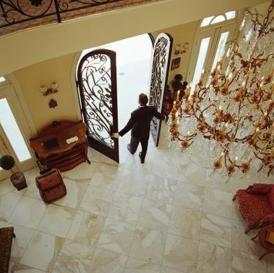 Elevated view of a doorman in a luxury building.