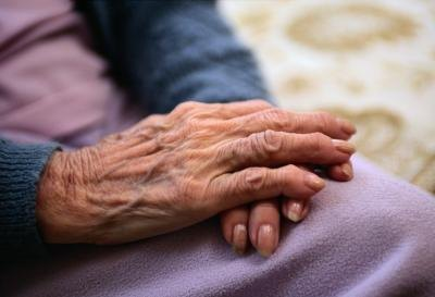 A close up of an elderly womans hands.