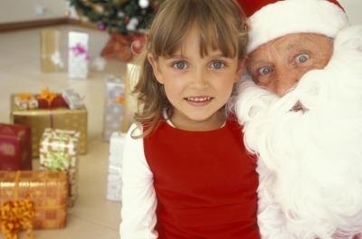 girl with santa at christmas party