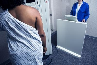 Woman getting mammogram.