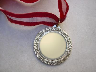 Award medal laying on table
