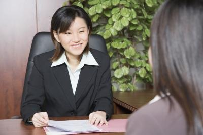 A business woman holding an internal interview.
