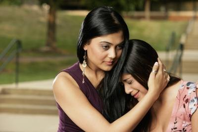 young girl crying with mother