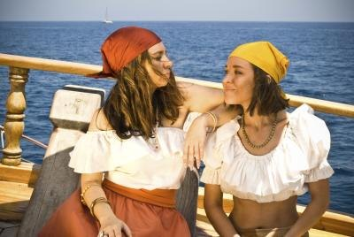 Two women dressed as pirates on boat