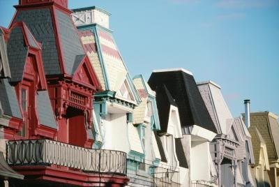 A close-up of Victorian style roof tops and balconies.