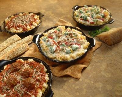 A variety of casseroles can be present at a potluck meal.