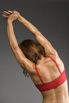 Stretch your back two to three times per week.