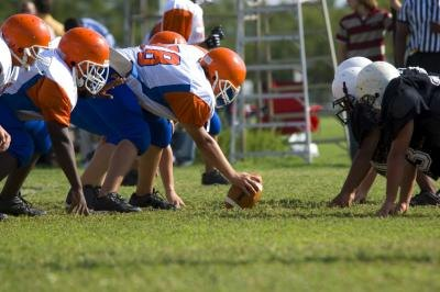Football players on the line of scrimmage