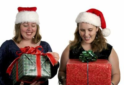 2 women exchanging holiday gifts.