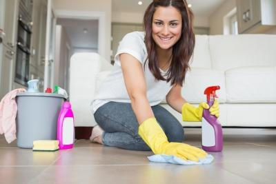 Woman cleaning living room floor