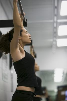 Hanging from a chin-up bar can keep your back healthy.