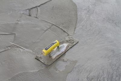 You can add more concrete to a concrete slab if you make a few preparations before your pour.