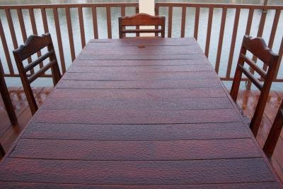 Wood table with chairs on patio.