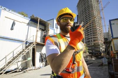 A safety manager is responsible for implementing programs to ensure compliance with safety regulations.