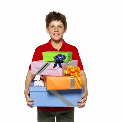 Boy holding birthday gifts
