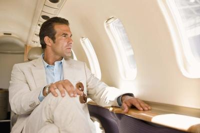 Wealthy businessman flying in first class
