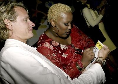 Signing a Broadway playbill.