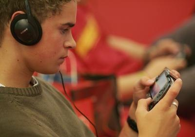 Young man with his PlayStation Portable