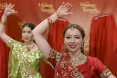 Bollywood women dancing in a red room