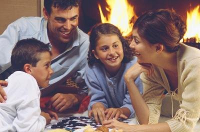 Family playing board game together.