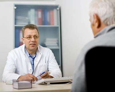 A man talks with his doctor about testosterone levels.