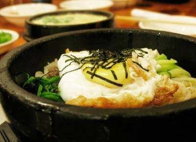 Bibimbap continues to cook at the table, in its traditional stone pot.