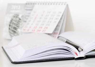 Calendar and journal open.