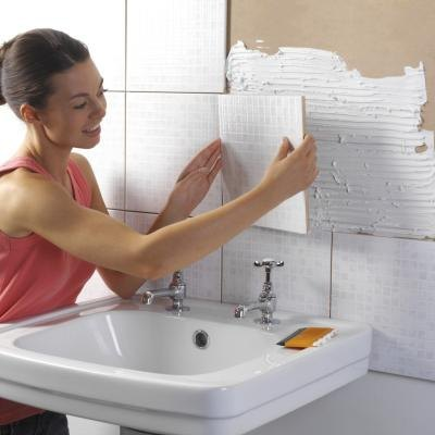 Woman renovating bathroom