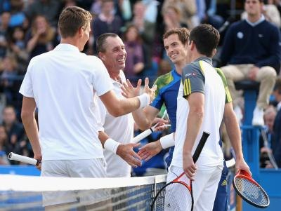 Tennis players shaking hands at match