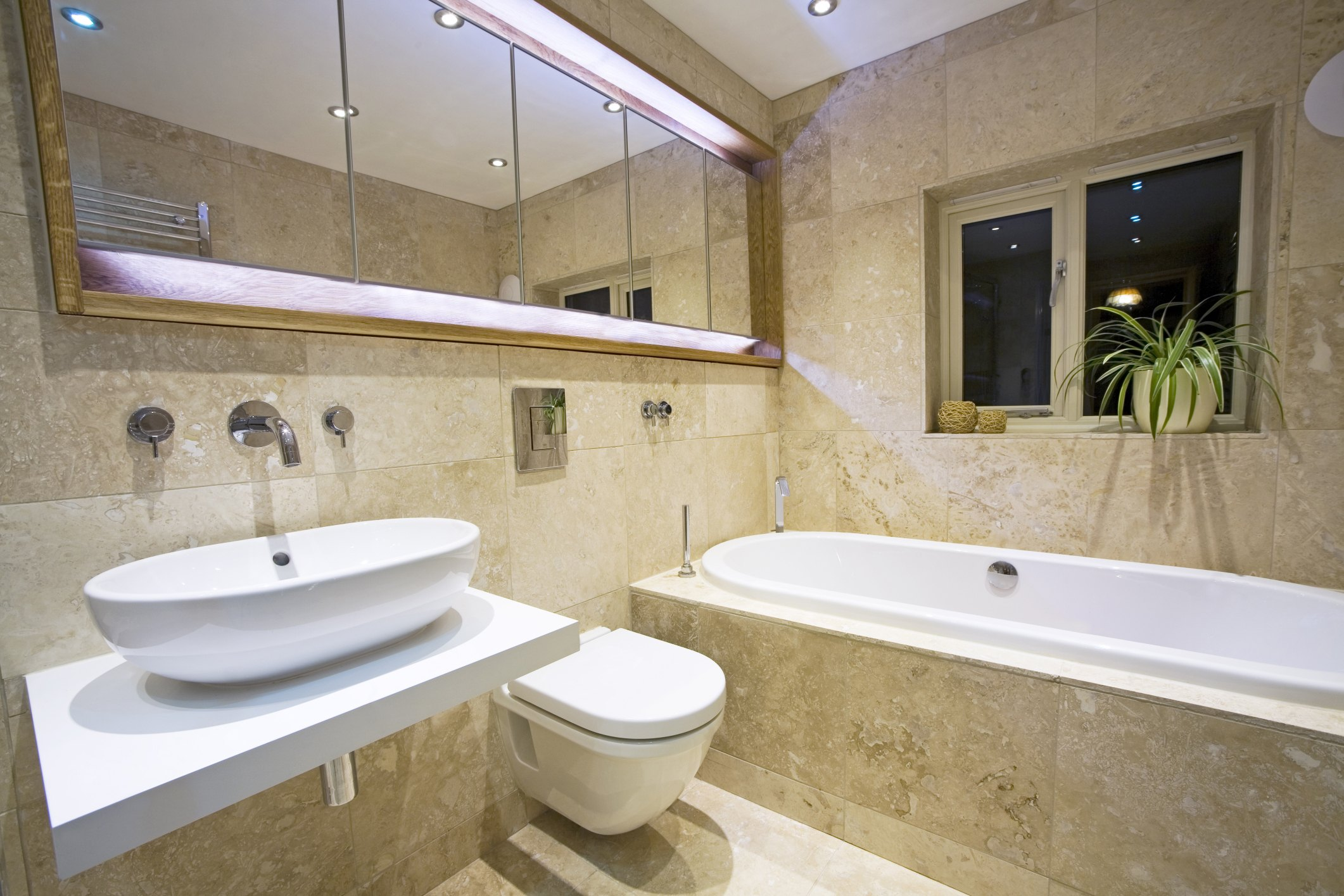 The average cost of retiling a bathroom with pictures ehow for Cost to retile bathroom floor