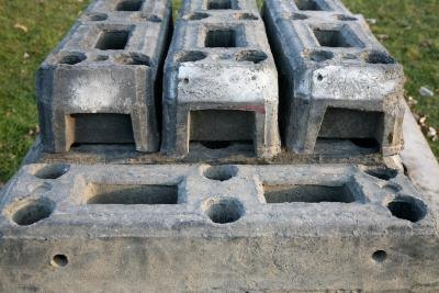 what is the cost difference between a poured concrete foundation a