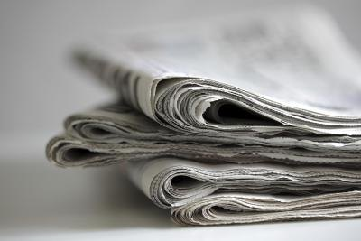 Close up of folded up newspaper.